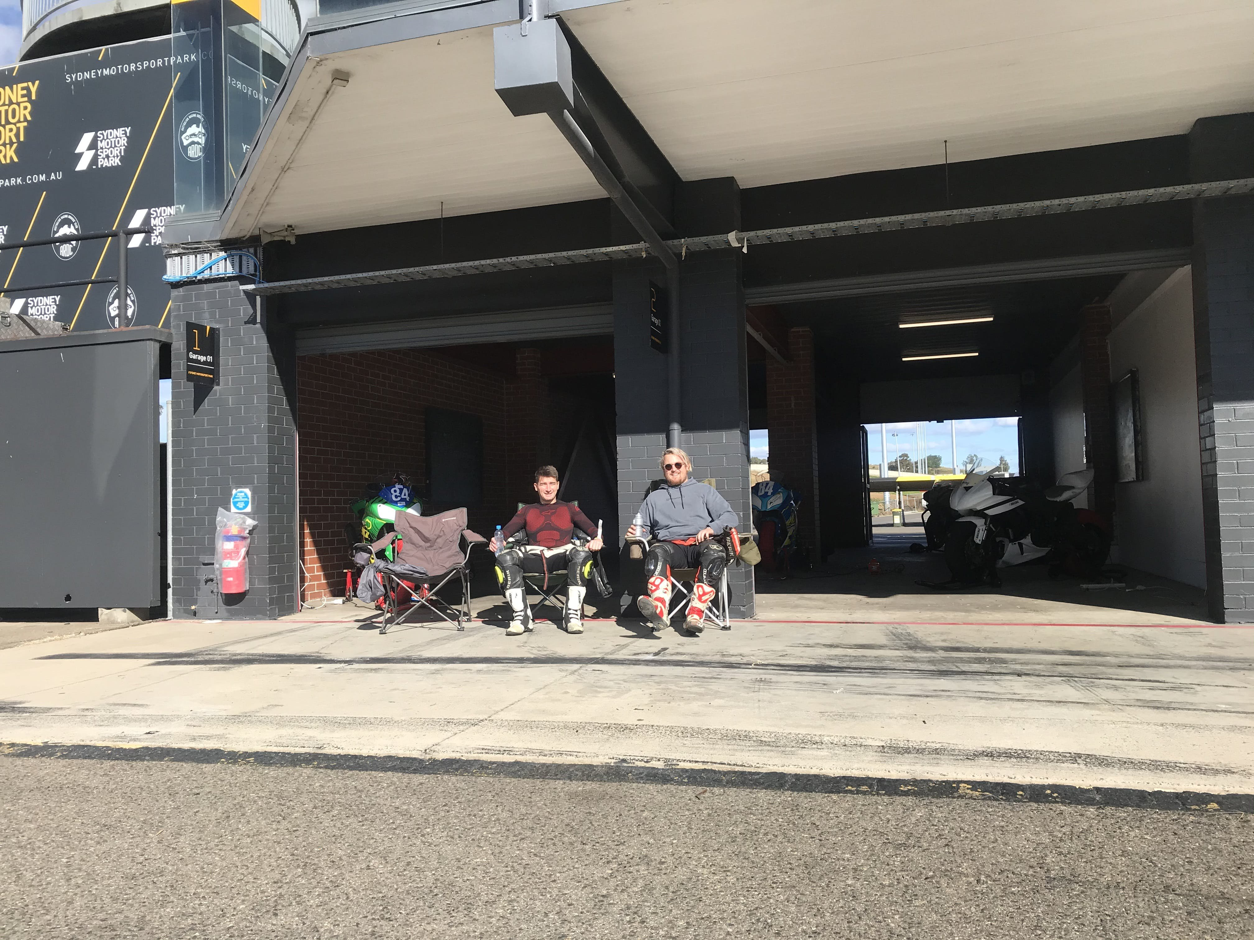 2 guys sitting in chairs in the sun at SMSP