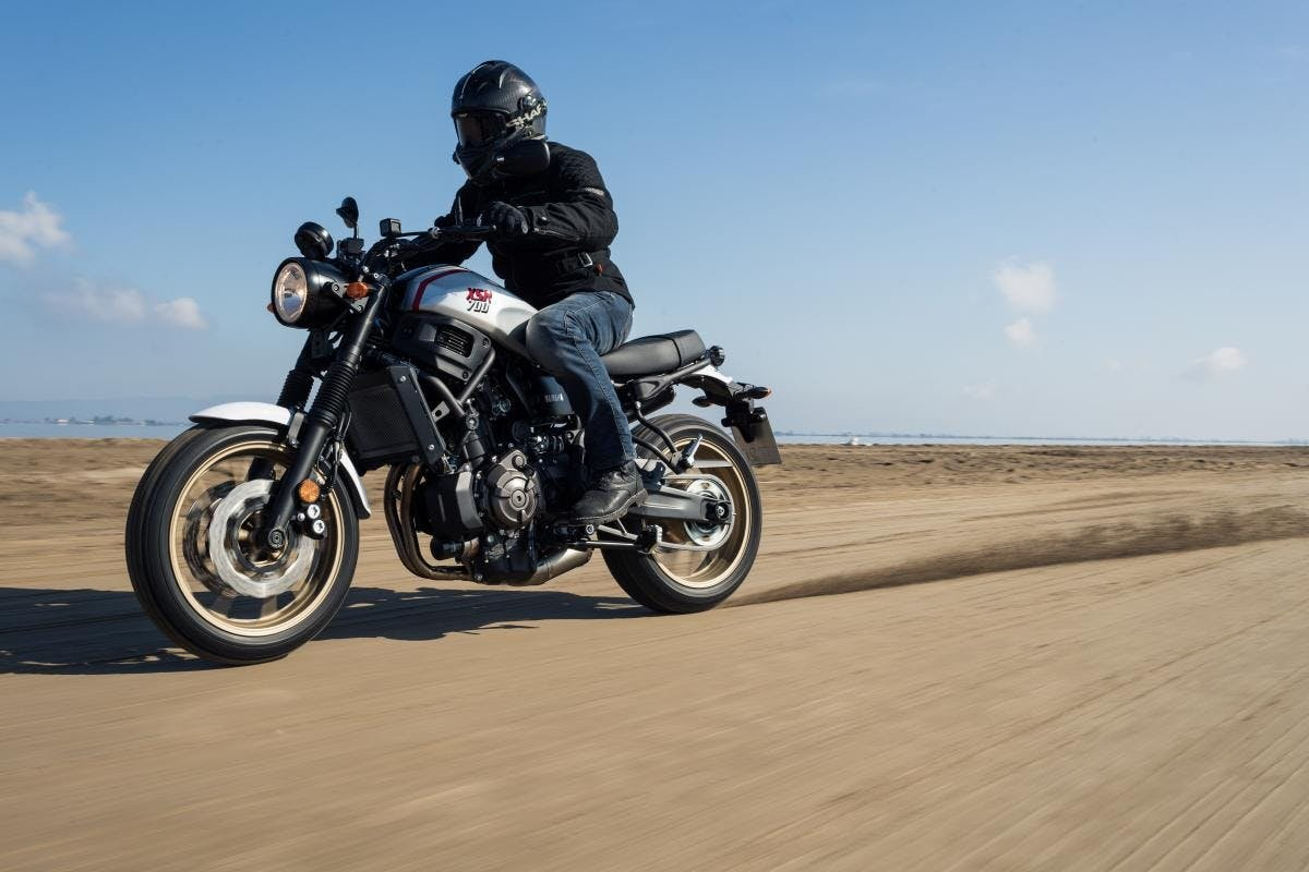 A safe motorcycle rider wearing all the safety equipment