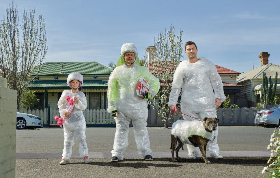 Family of 3 and a dog covered in bubblewrap