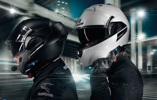 sharktooth on a black evoline helmet that is opened, and a white Evo-line helmet that is closed