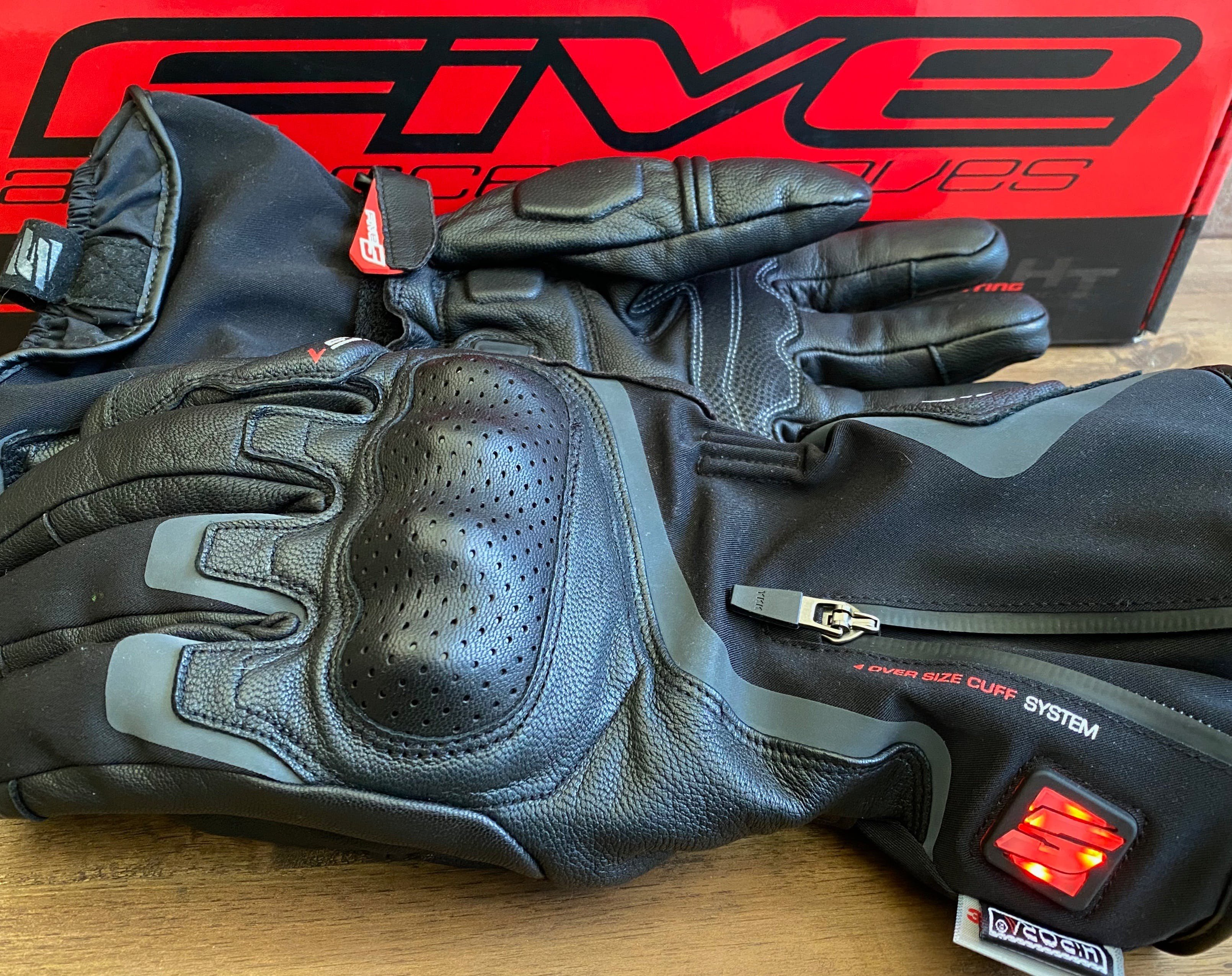A pair of Five HG-1 gloves in front of their red box