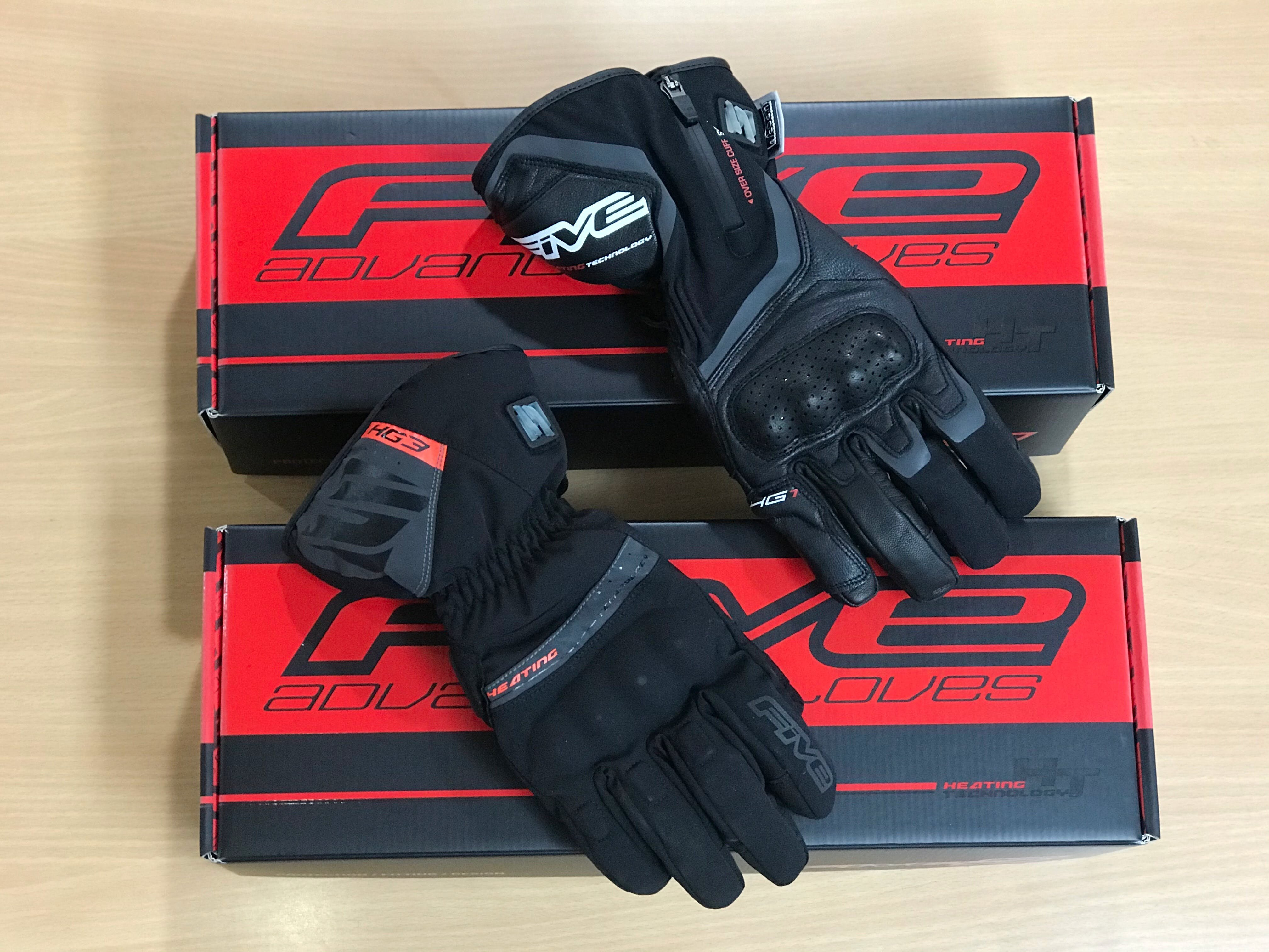Five HG3 and HG1 heated gloves side by side on top of two glove boxes
