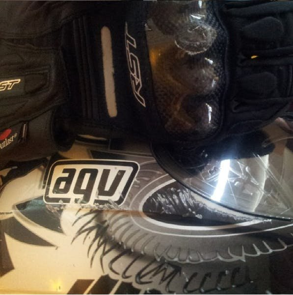 AGV helmet with scratches and dent on carbon knuckles of gloves