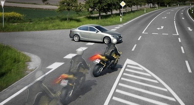 A car pulling out in front of a motorcycle