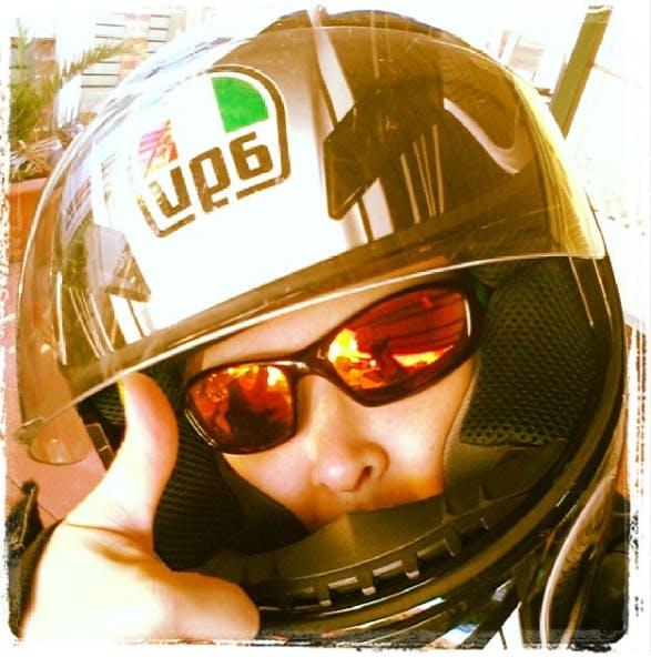 Girl in helmet giving thumbs up