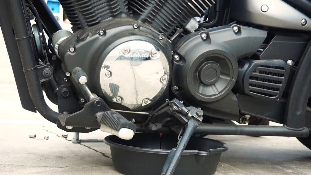 Oil pan under a motorcycle