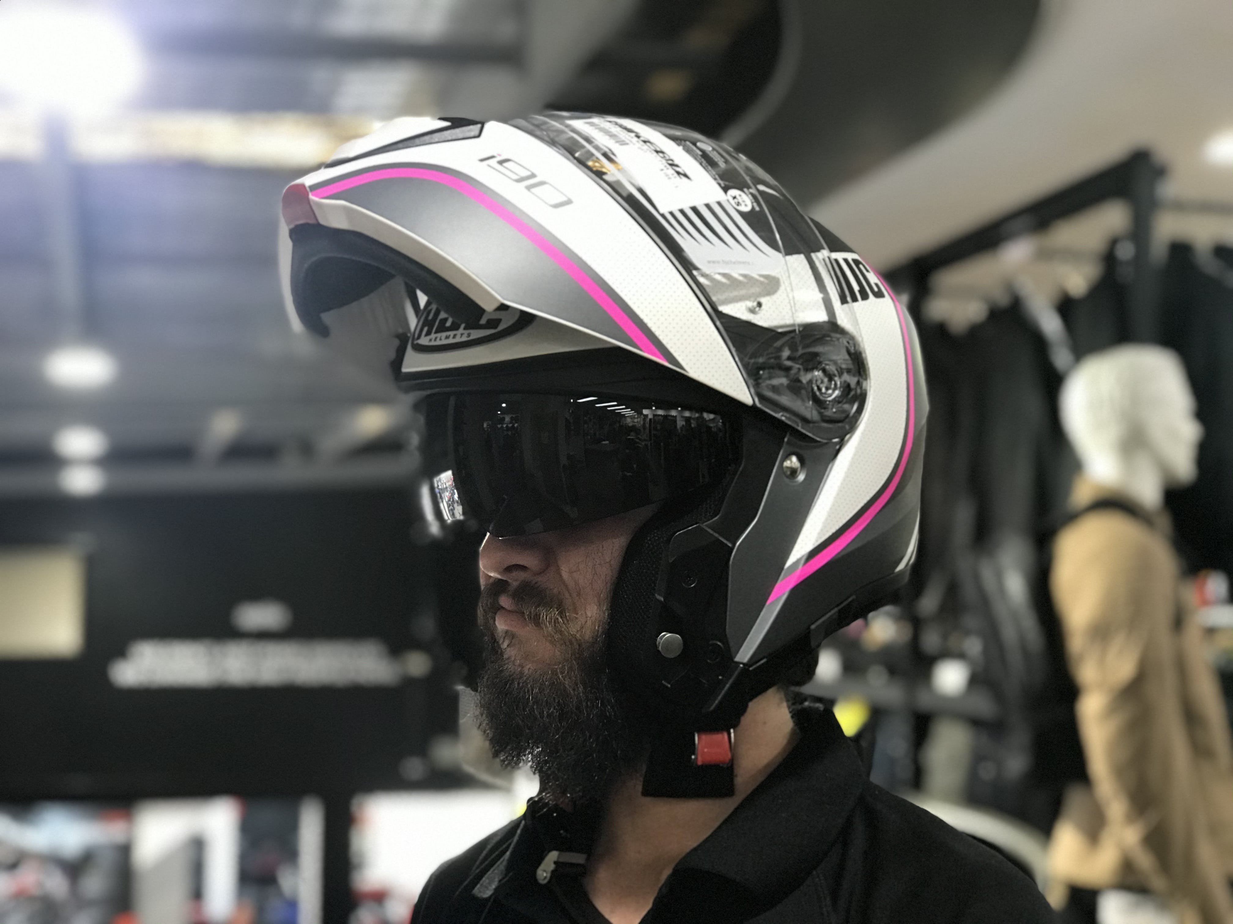 Andrew in a modular helmet white and pink