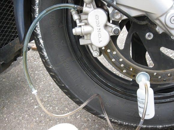 Motorcycle brakes being bleed