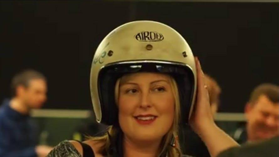 A woman in an Open Face helmet