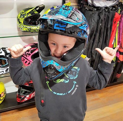 Young boy in dirt bike helmet