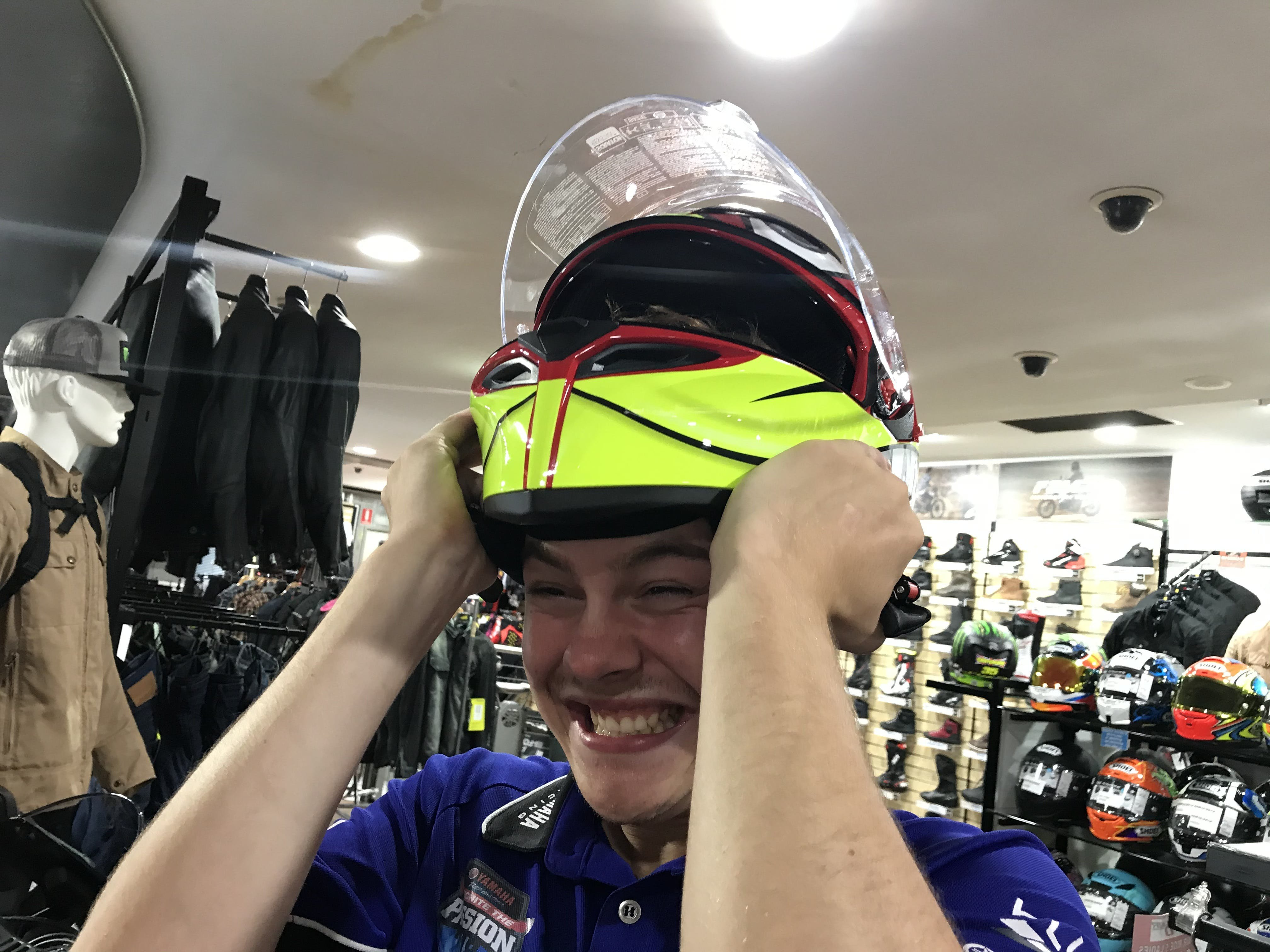 Guy straining to take a motorcycle helmet off