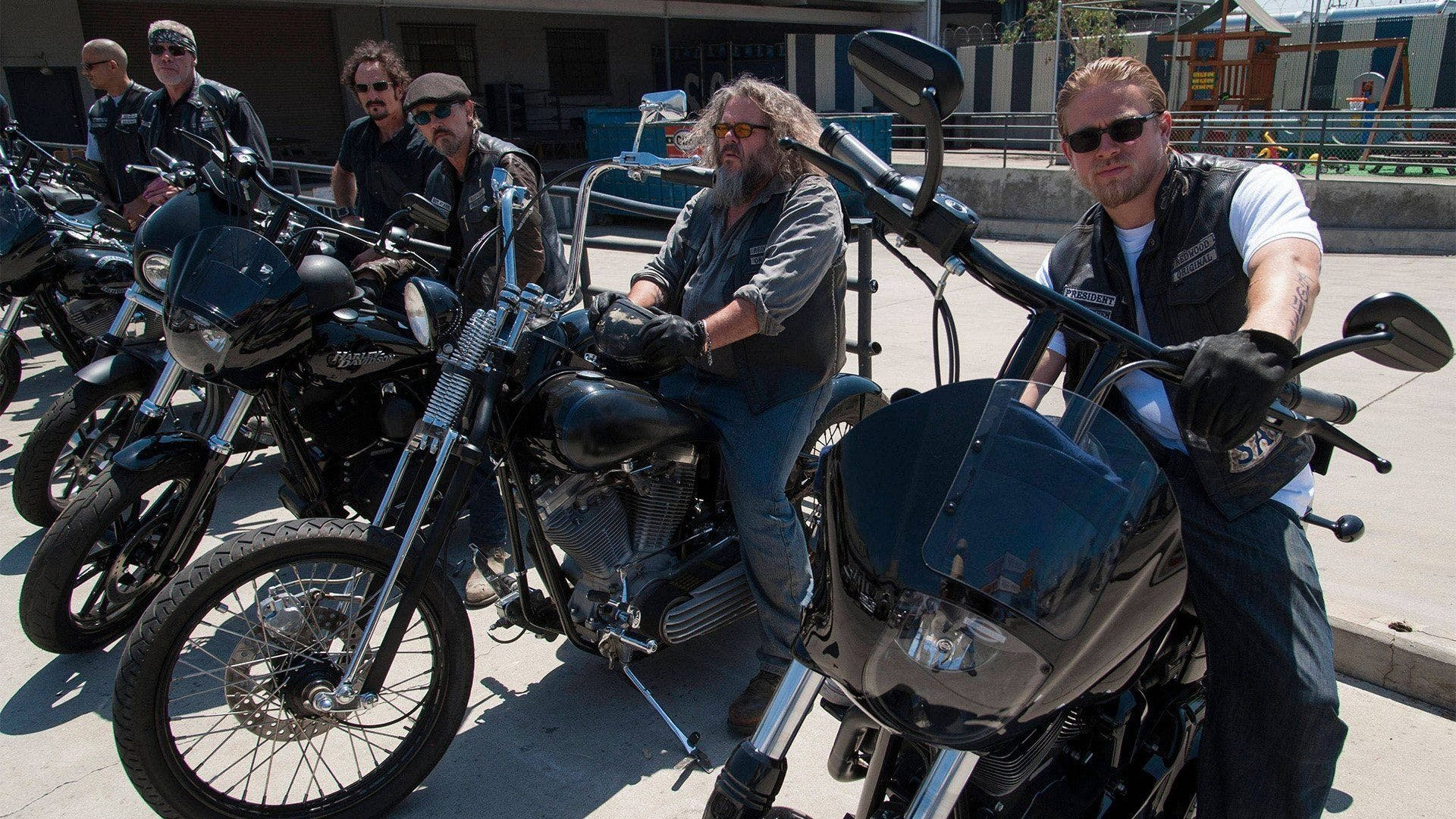 Some of the sons of anarchy cast on motorcycles
