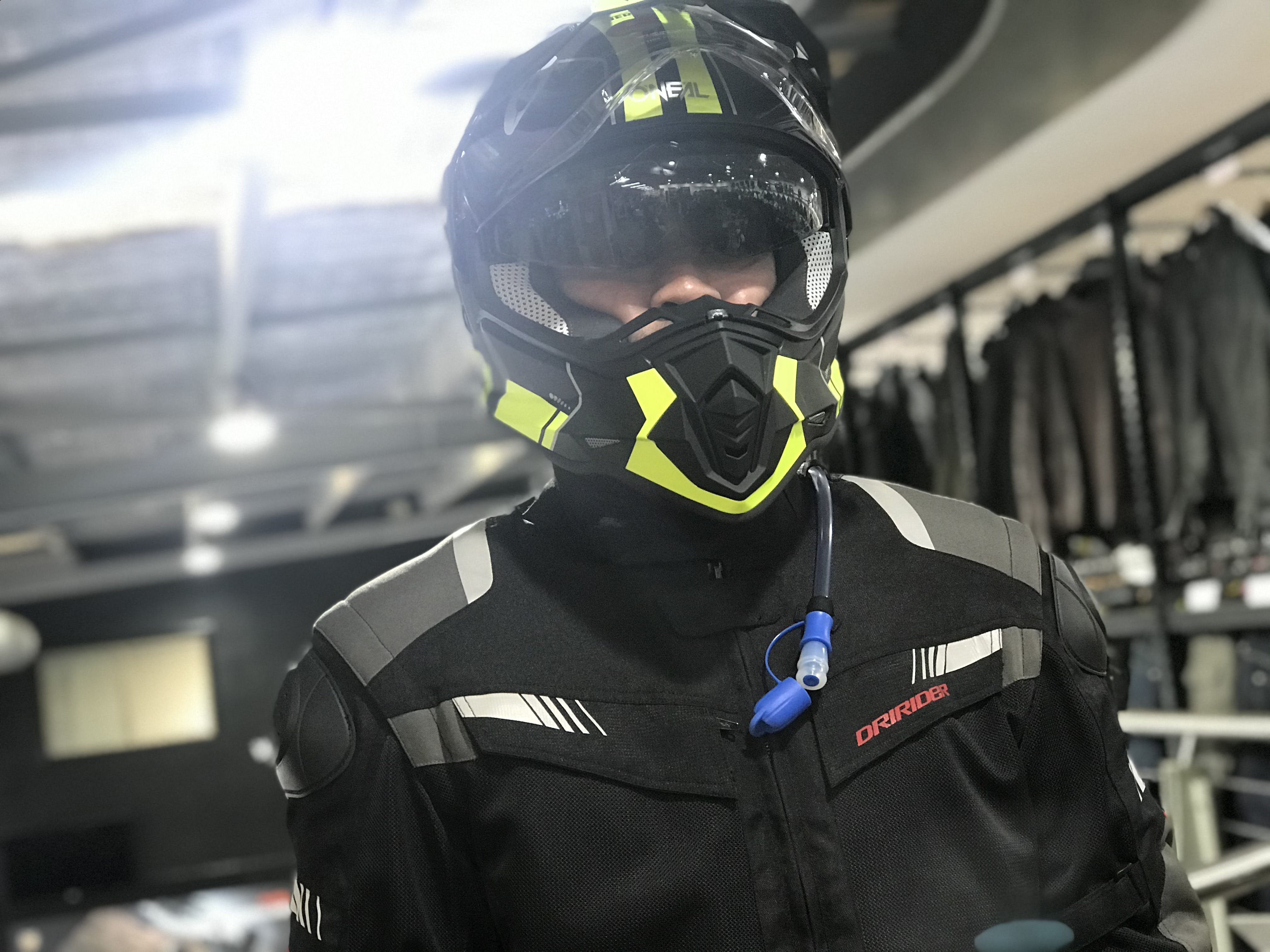 James in a black and yellow dual sport helmet