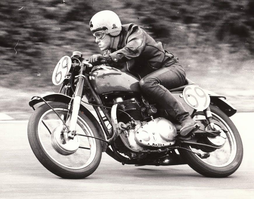 Old motorcycle racer on vintage motorcycle