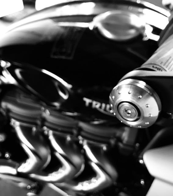 Bar end of a Triumph Rocket 3R with stock exhuast headers in the background