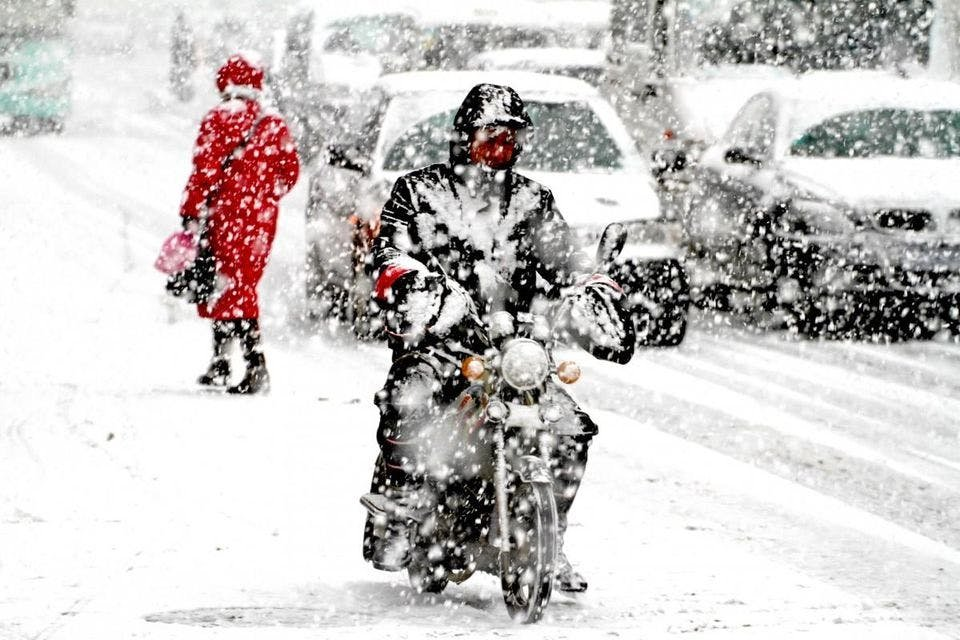 Guy riding a motorcycle in the snow