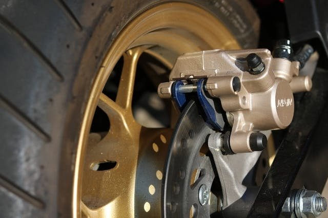 The rear brake on a motorcycle