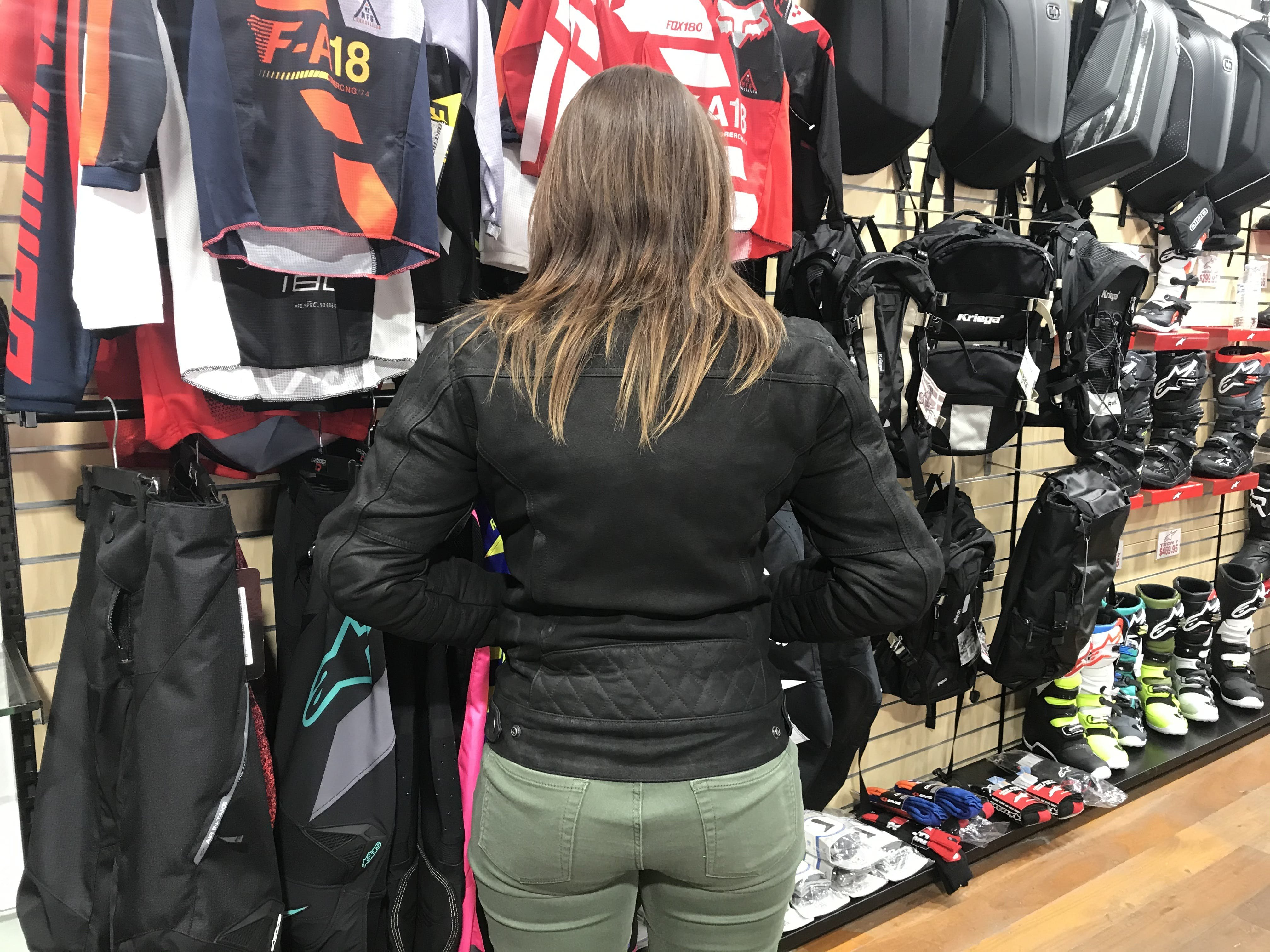 woman wearing and showing the back of the Merlin Mia Jacket