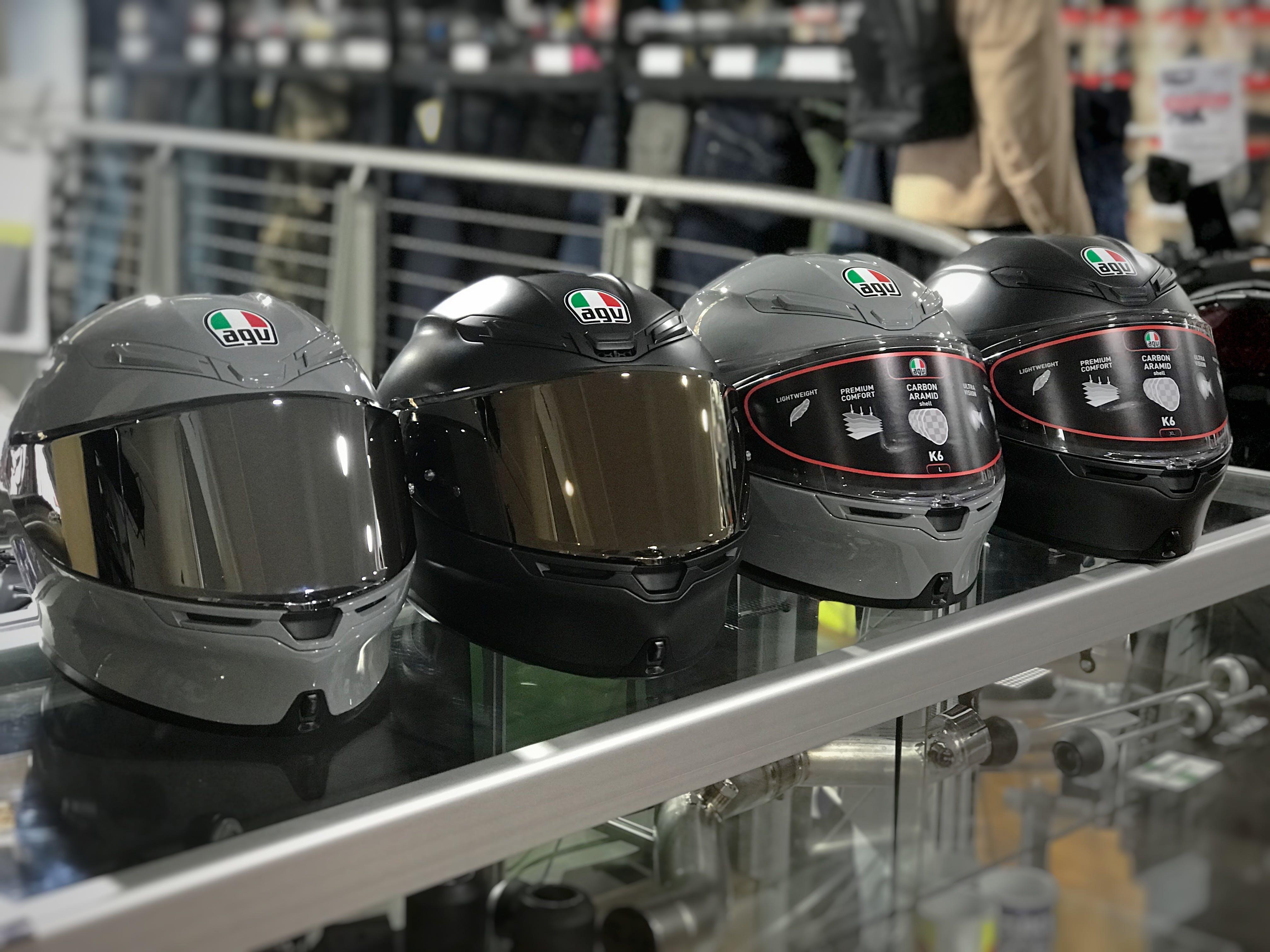 2 grey and 2 black AGV K6 road helmets