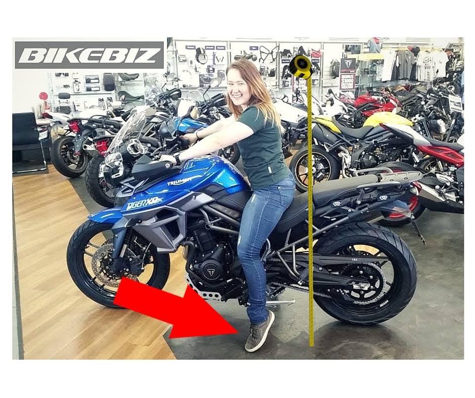 Short woman on a triumph tiger xox low adventure bike