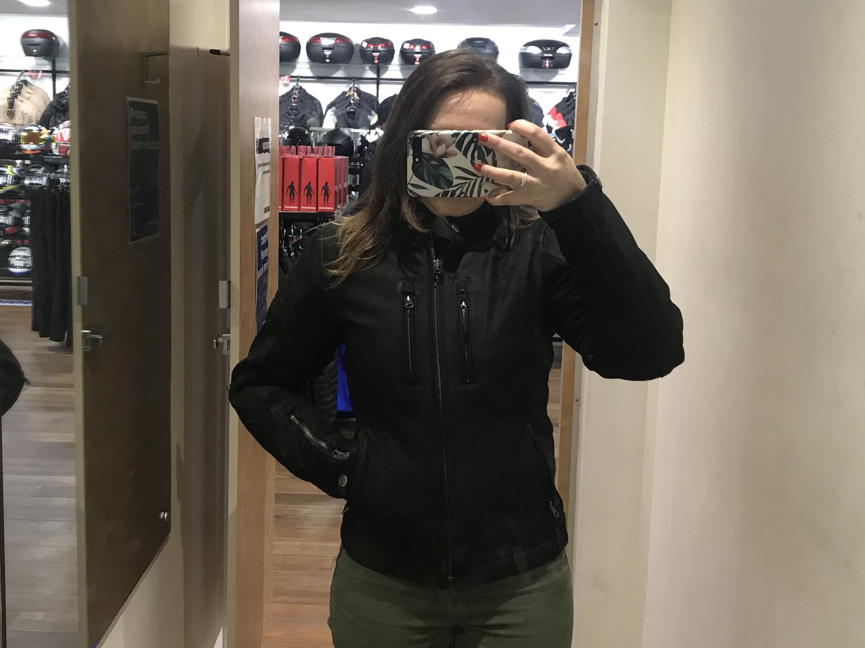 A woman in the Merlin Mia black leather motorcycle jacket