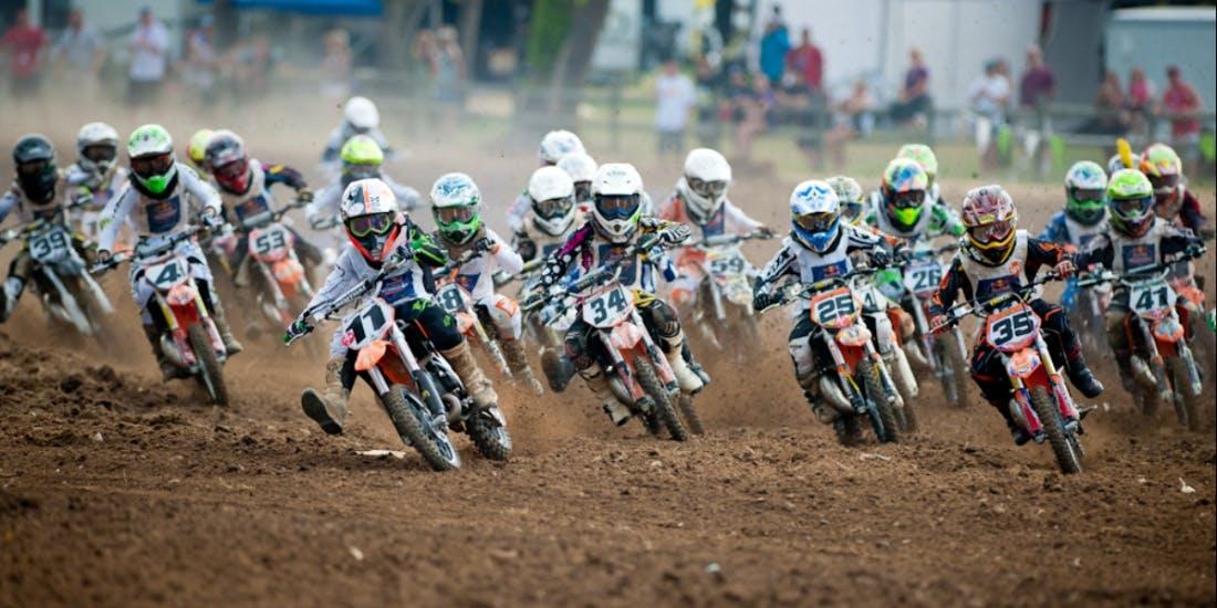 Large group of kids racing motocross