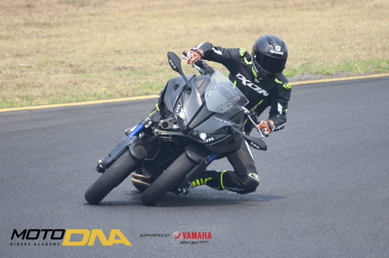 Guy  on the track in full leathers, riding a Yamaha Niken